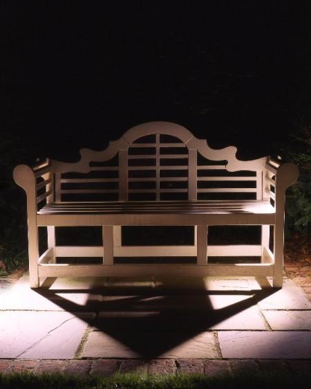 Cross lighting effect on a garden bench